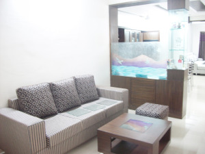 Living room with Aquarium partition  looking through the dining