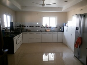 Full view of white and bright kitchen